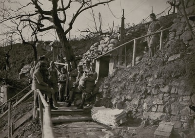 grayscale photography of soldiers outside cave troops teams background