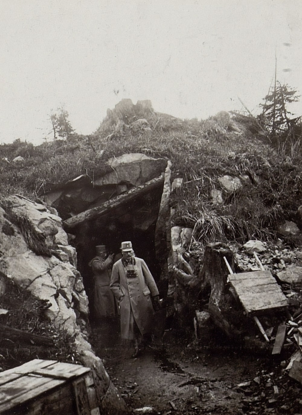 grayscale photography of men coming out of a mining tunnel