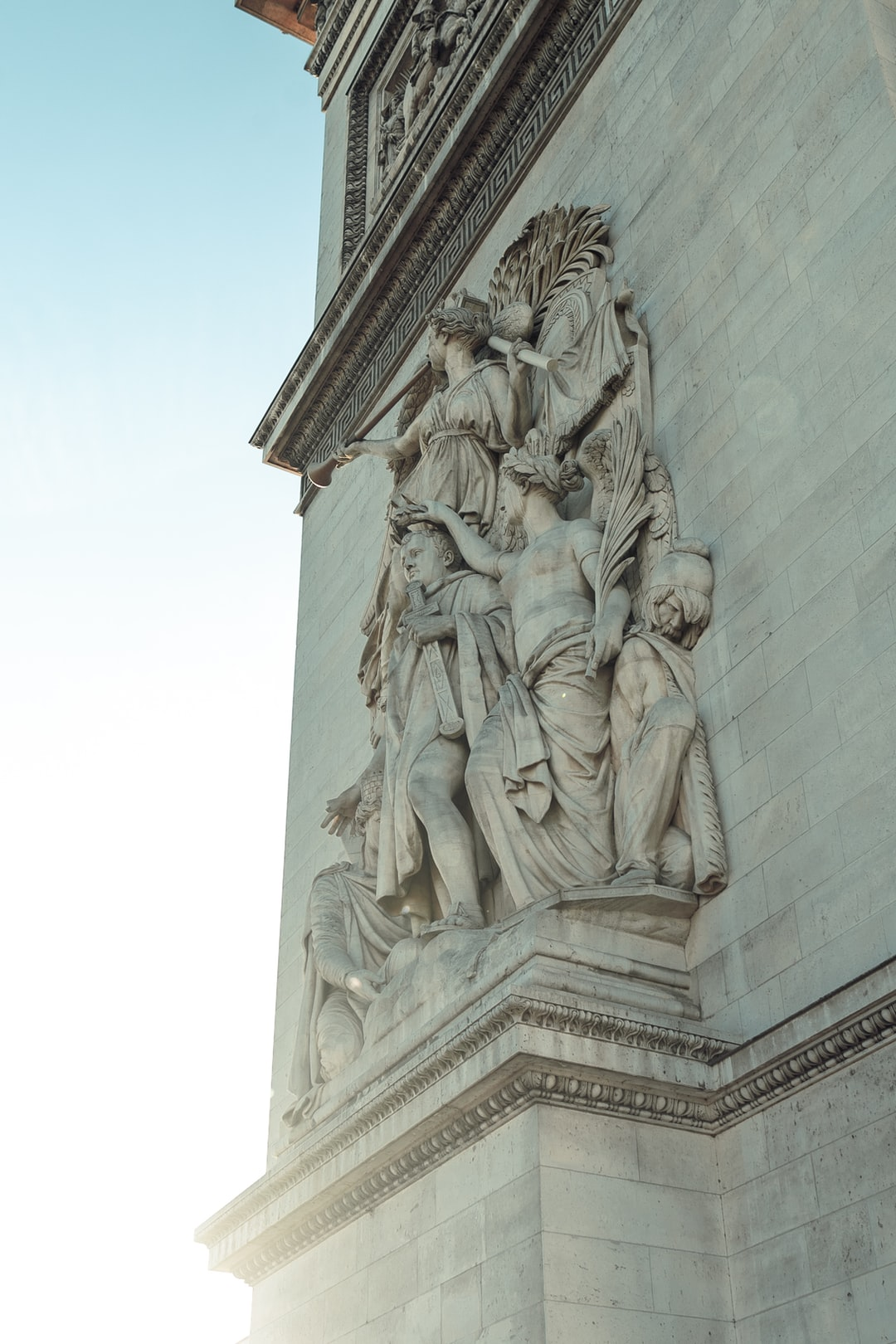 A view of the statues on the Arc De Triomphe in Paris, France
