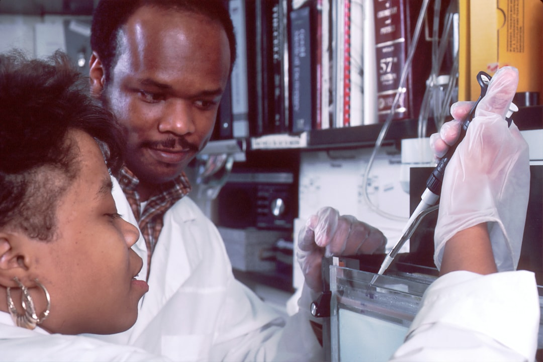 man and woman doing laboratory works