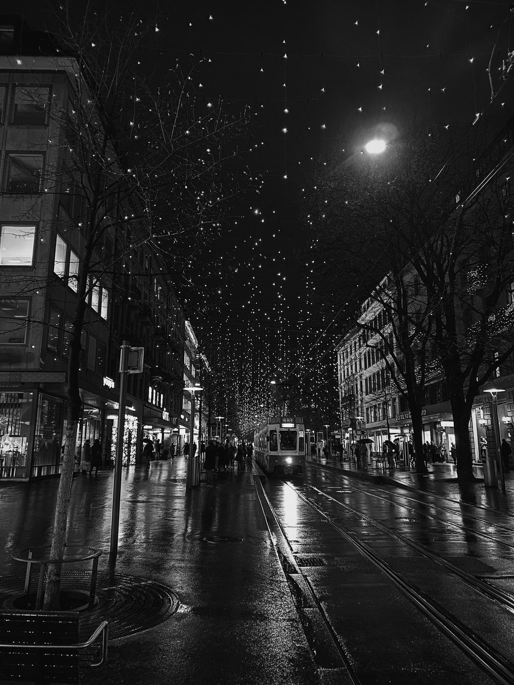 grayscale photography of tram at night