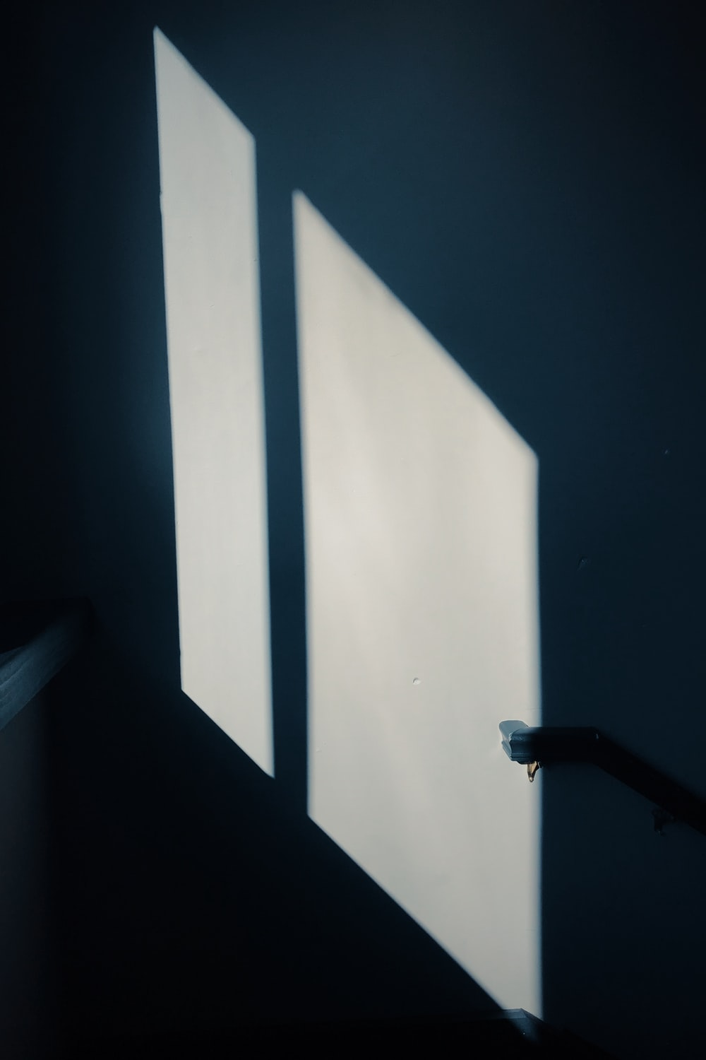 shadow of a window on white wall