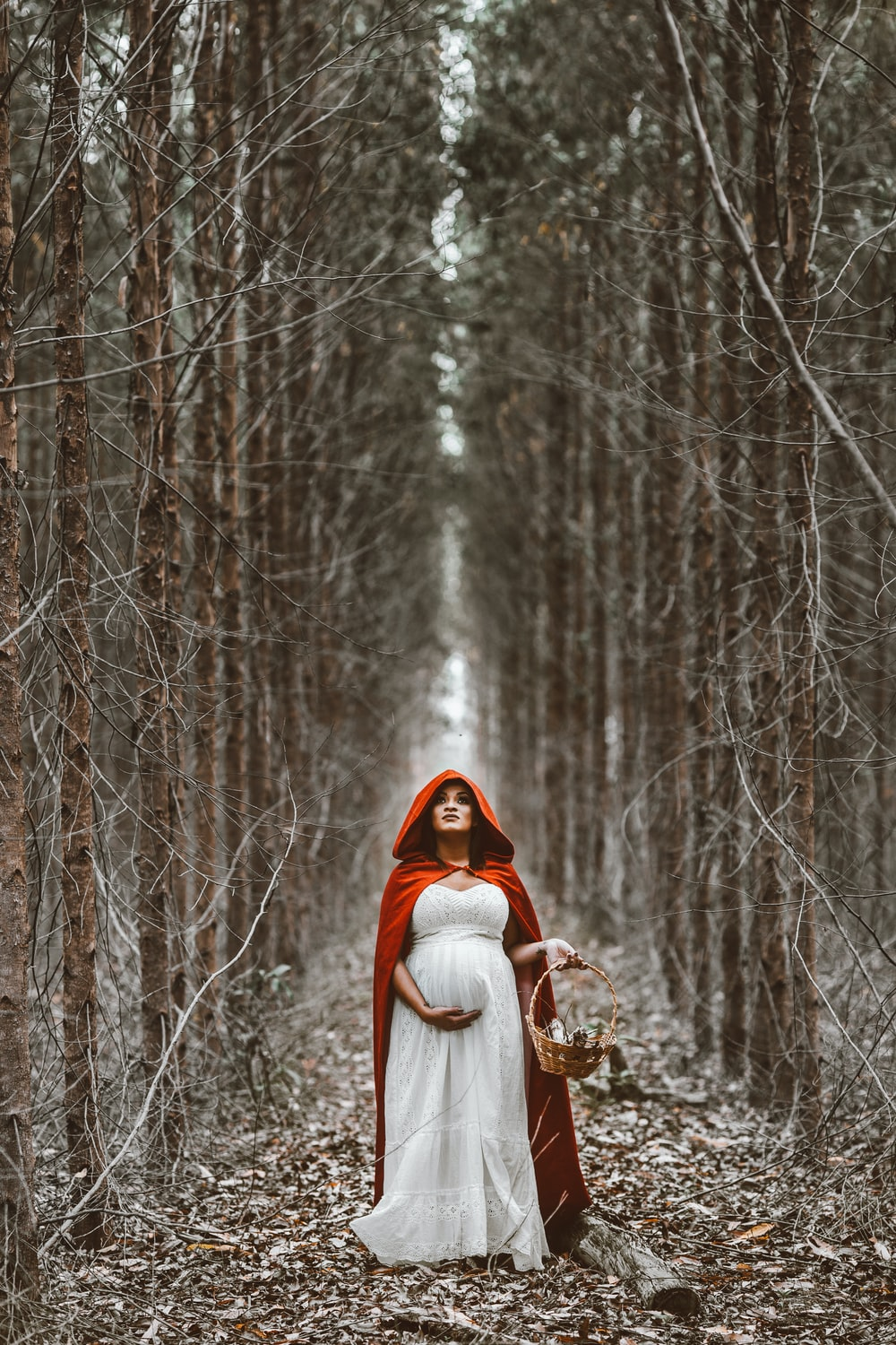 woman holding basket standing on pathway