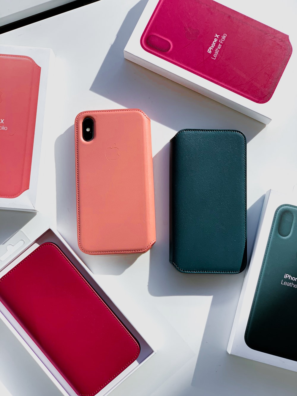 pink iPhone X among boxes
