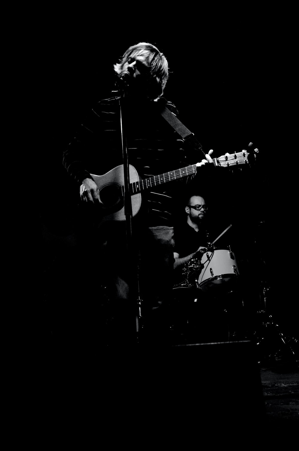 person performing in greyscale photography