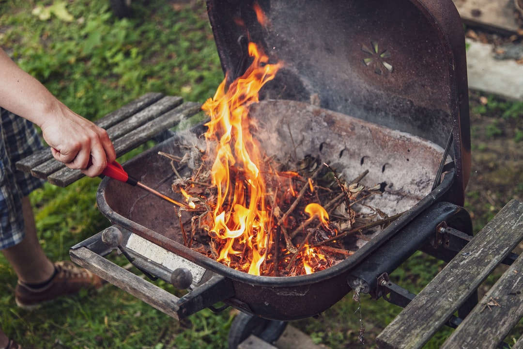 Starting fire on barbecue.