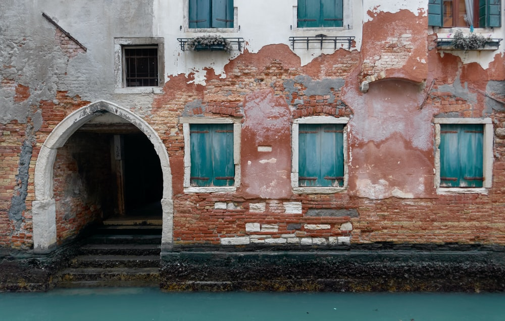 view photography of brown concrete building in water