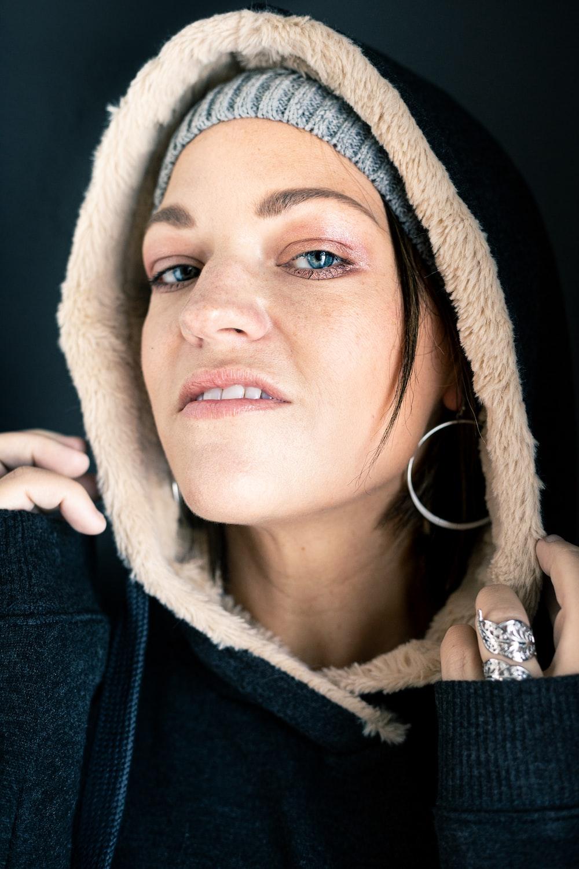 woman wearing black and brown fur hoodie