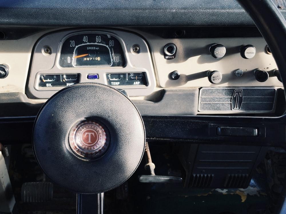 black steering wheel inside vehicle