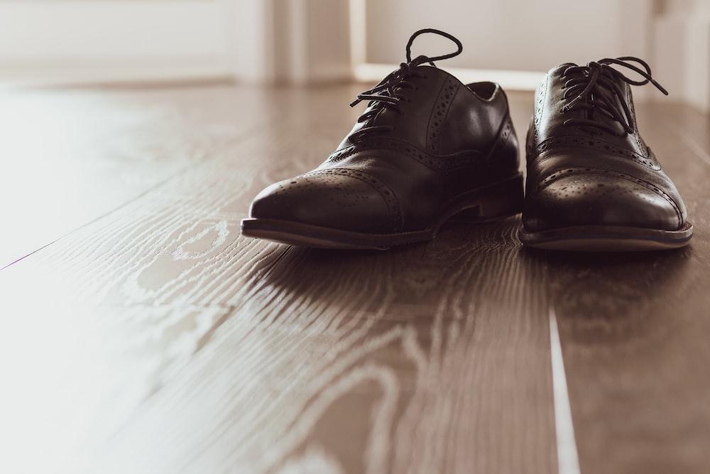 pair of brown wingtip shoes