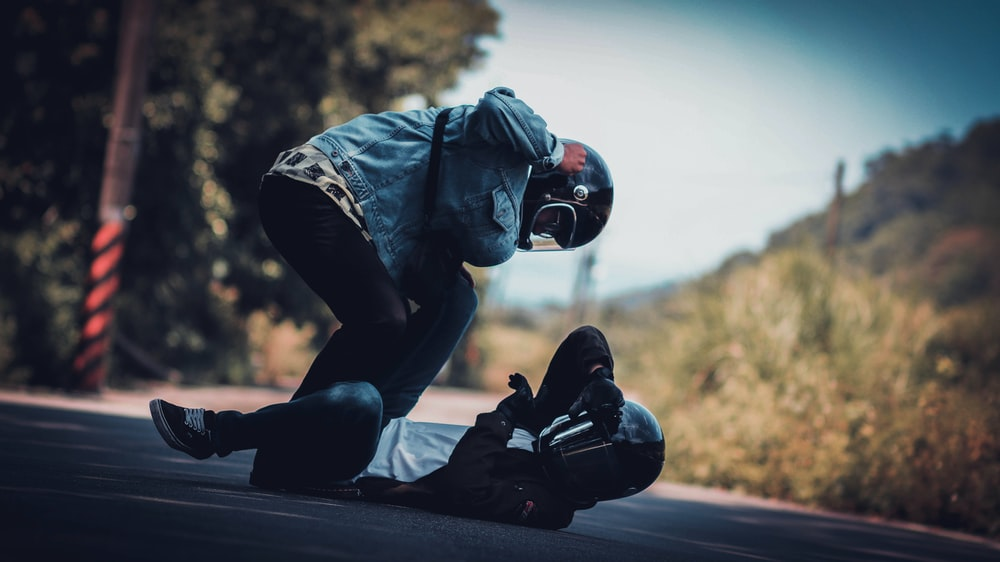 shallow focus photo of person wearing full-face motorcycle helmet