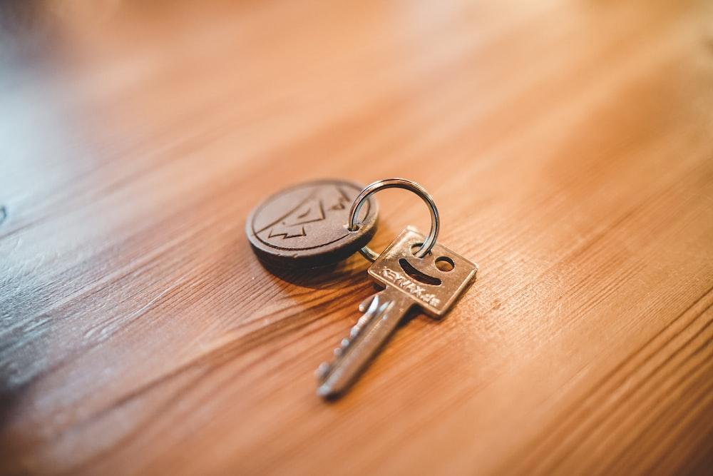silver key on tabletop