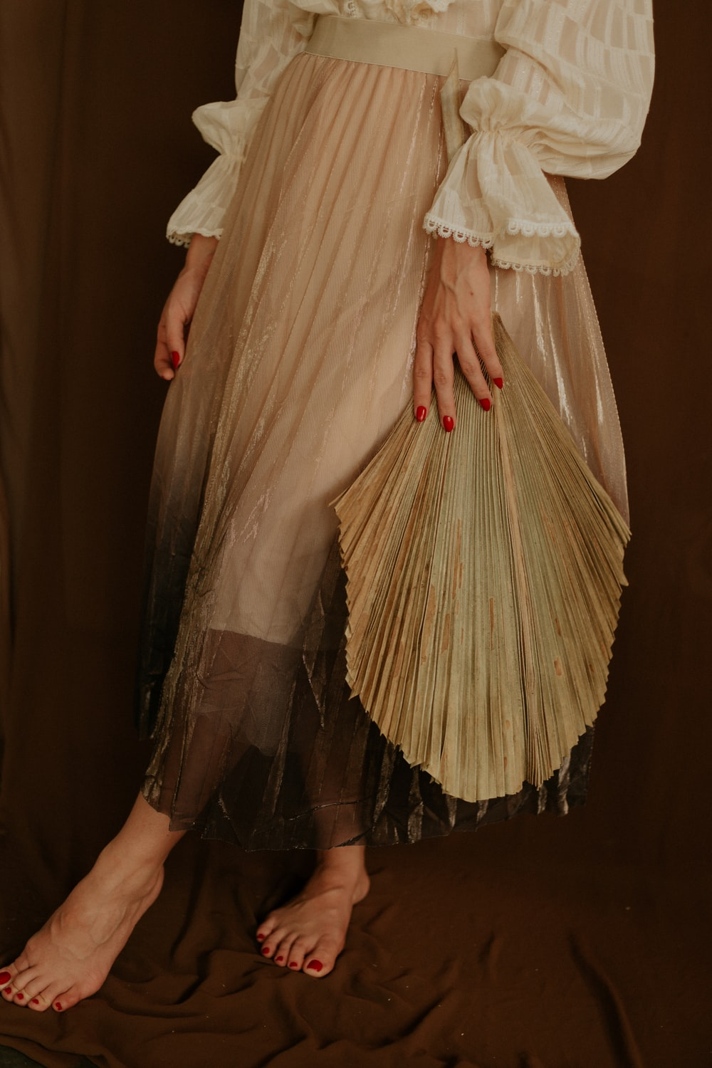 woman wearing brown long-sleeved dress