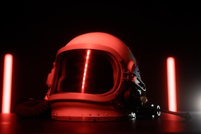 Space Helmet with red lights in the background and foreground