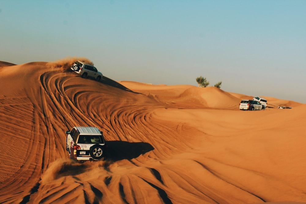 vehicles on desert during daytime