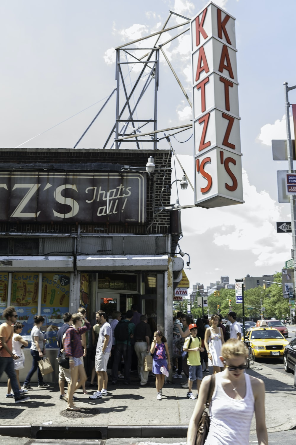 crowd in front of Katz's building during daytime
