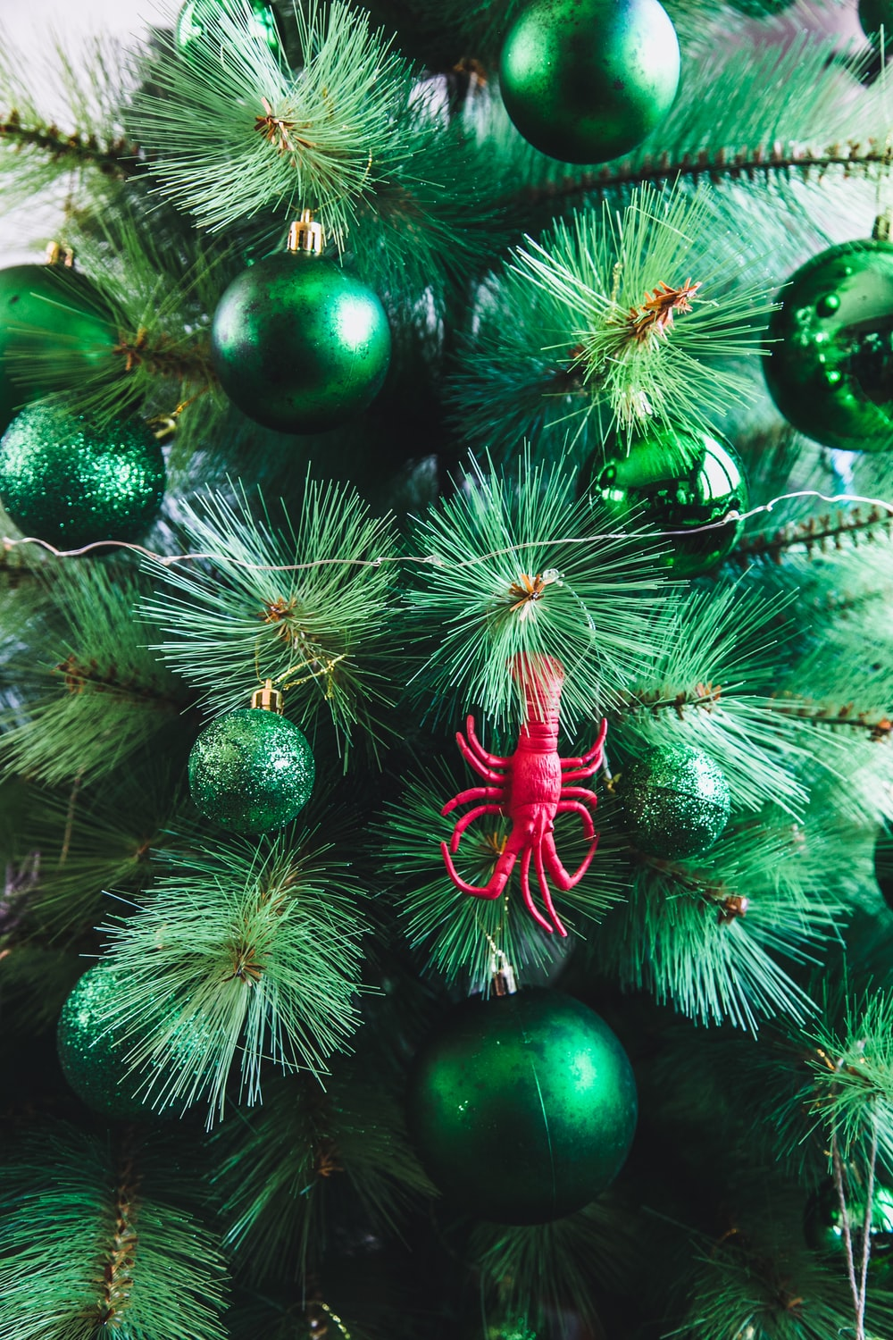 green baubles on Christmas tree