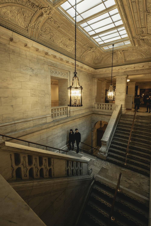 few people walking inside historic building
