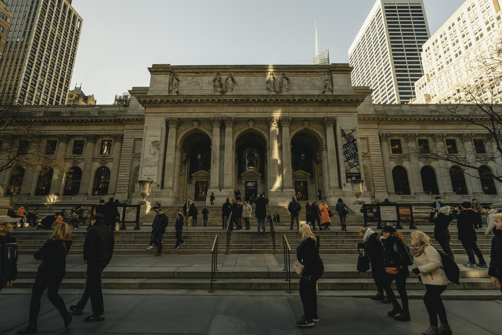 people walking near New York Public library during daytime