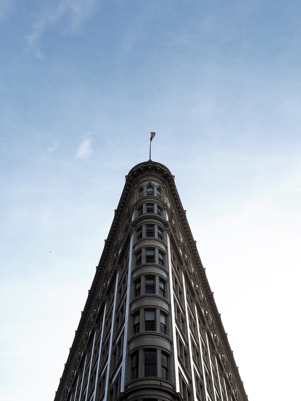 Flatiron in New York City under white and blue sky