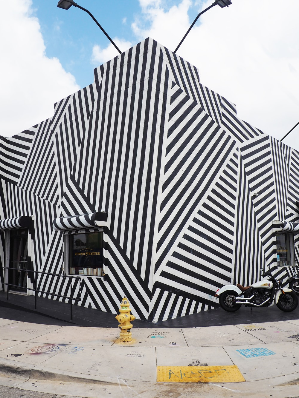 white and black striped concrete building under white and blue sky