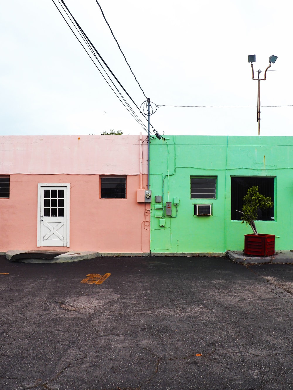 two green and pink concrete houses