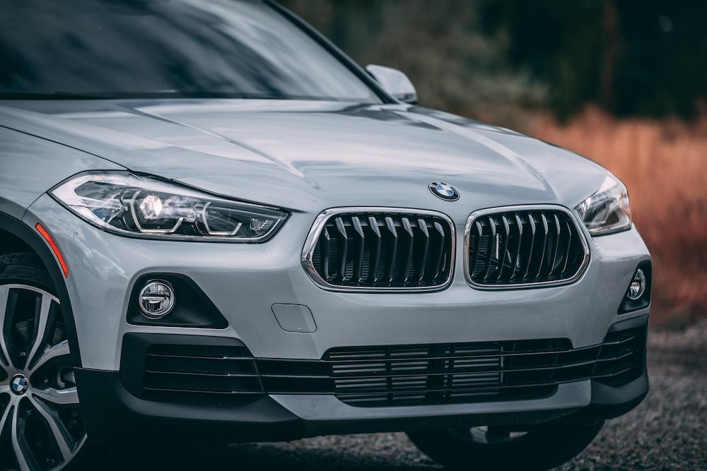 silver BMW X1 parking near road