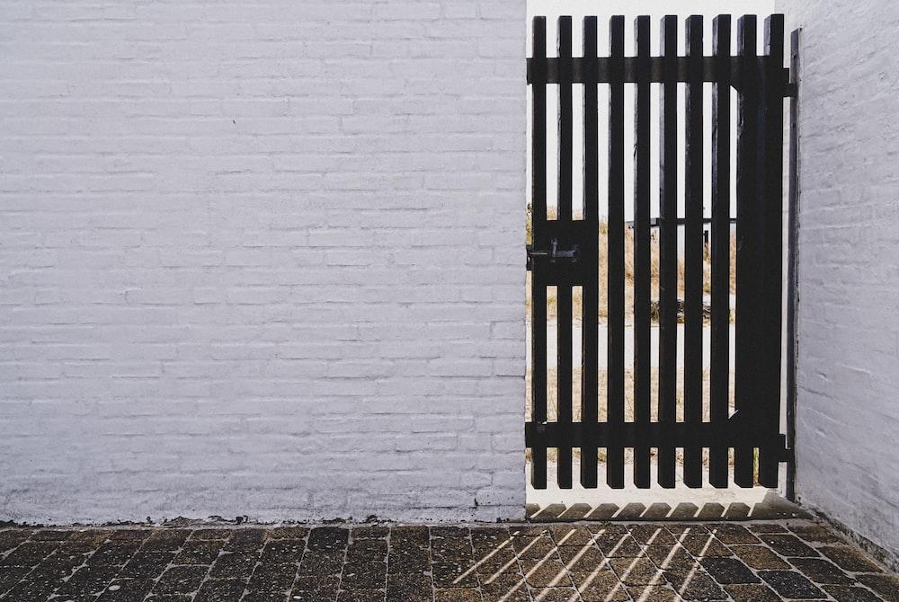 black gate panel with black metal gate latch