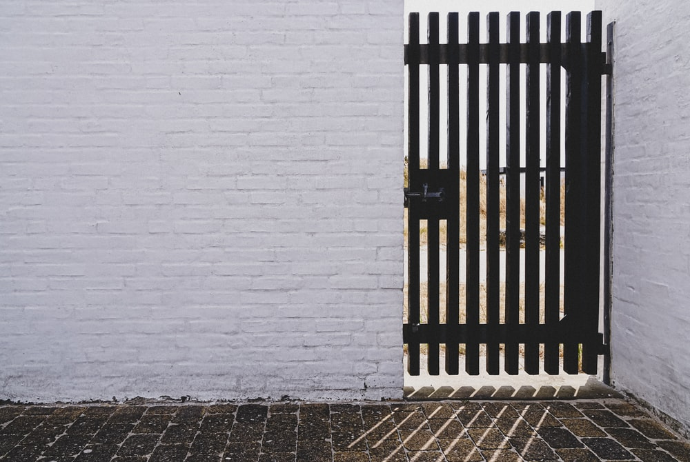 black gate panel with black metal gate latch