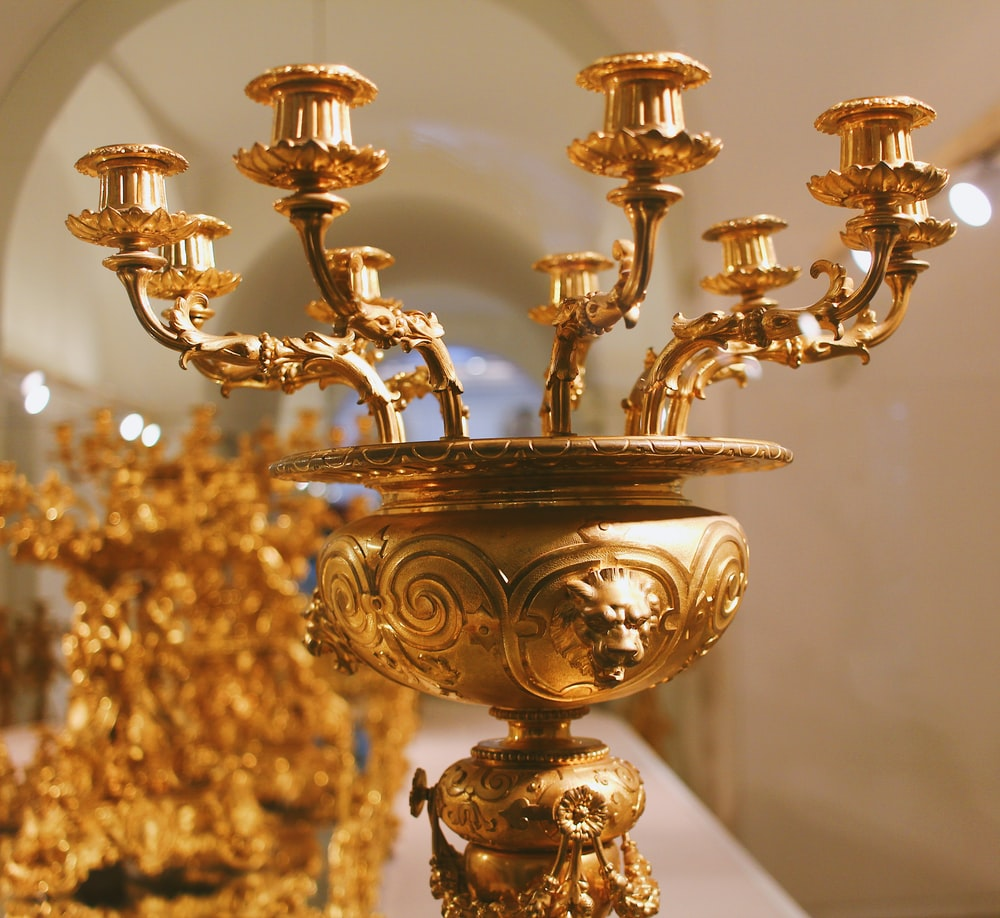 closeup photo of gold metal candle holder