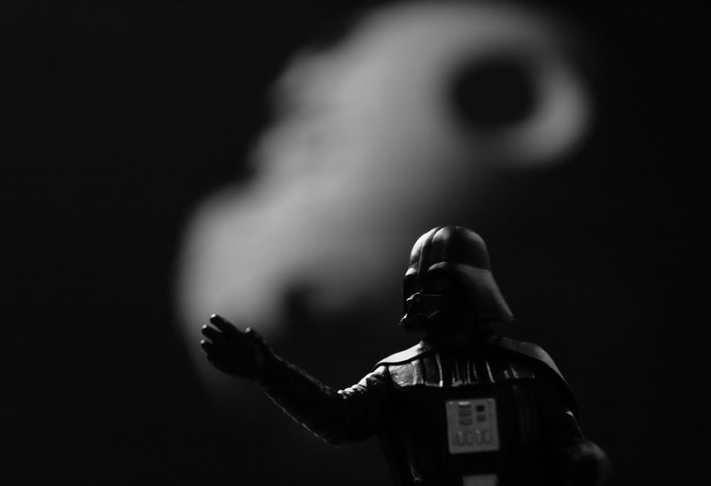 grayscale photo of Star Wars Darth Vader action figure