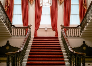 inside building with red carpet on stairs