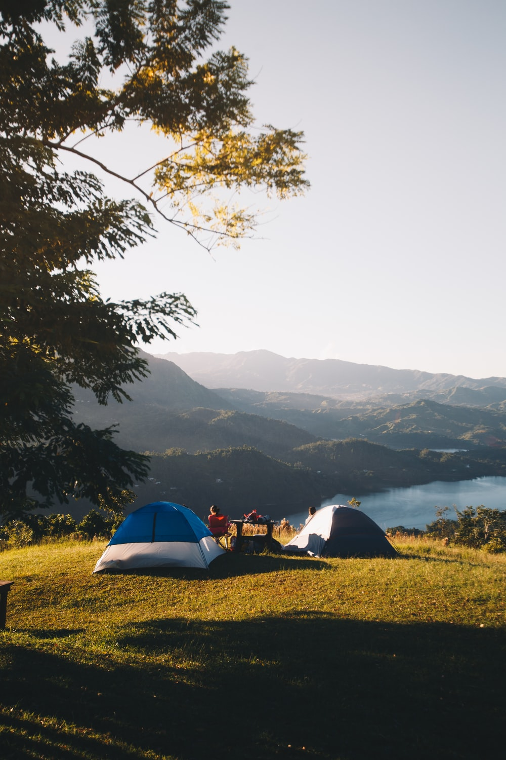 set-up tents near body of water