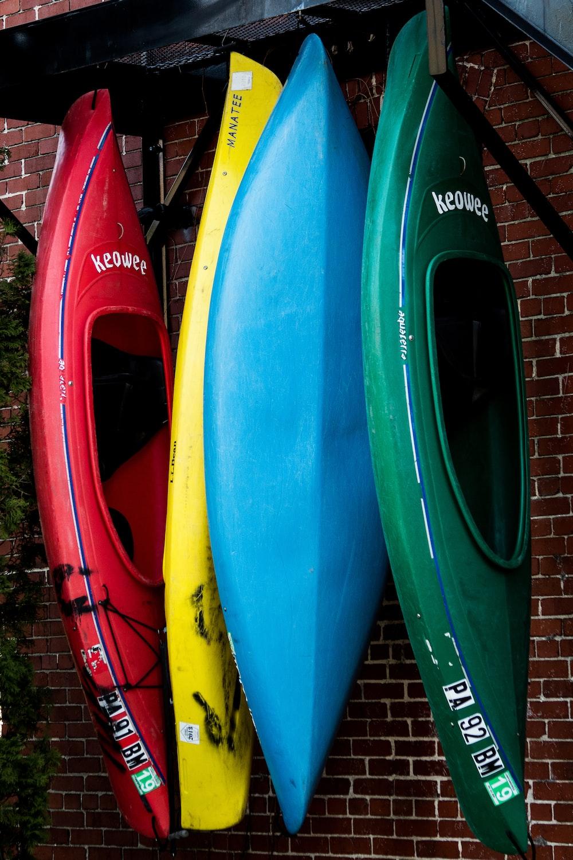 assorted-color kayak on display