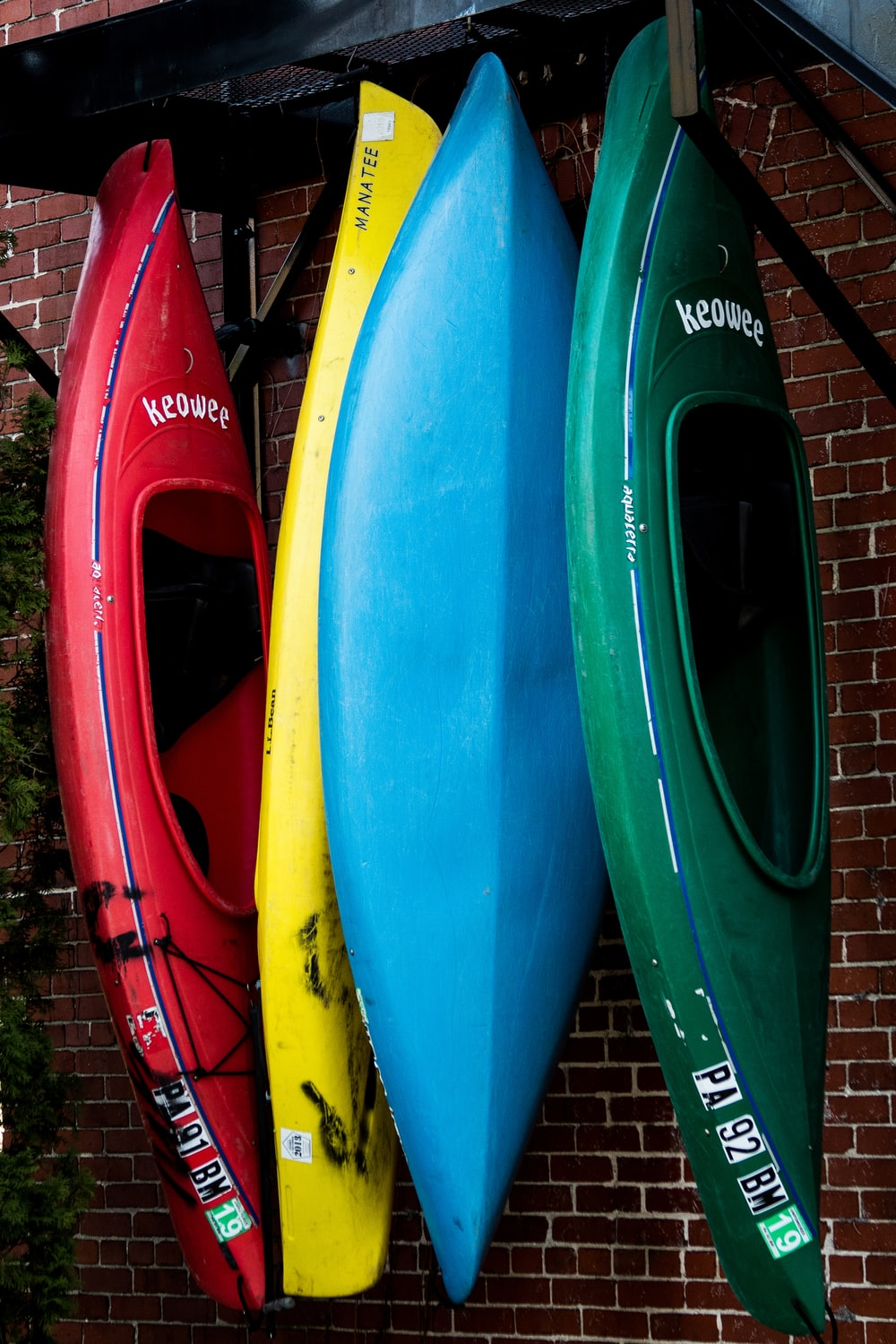 assorted-color kayak on display