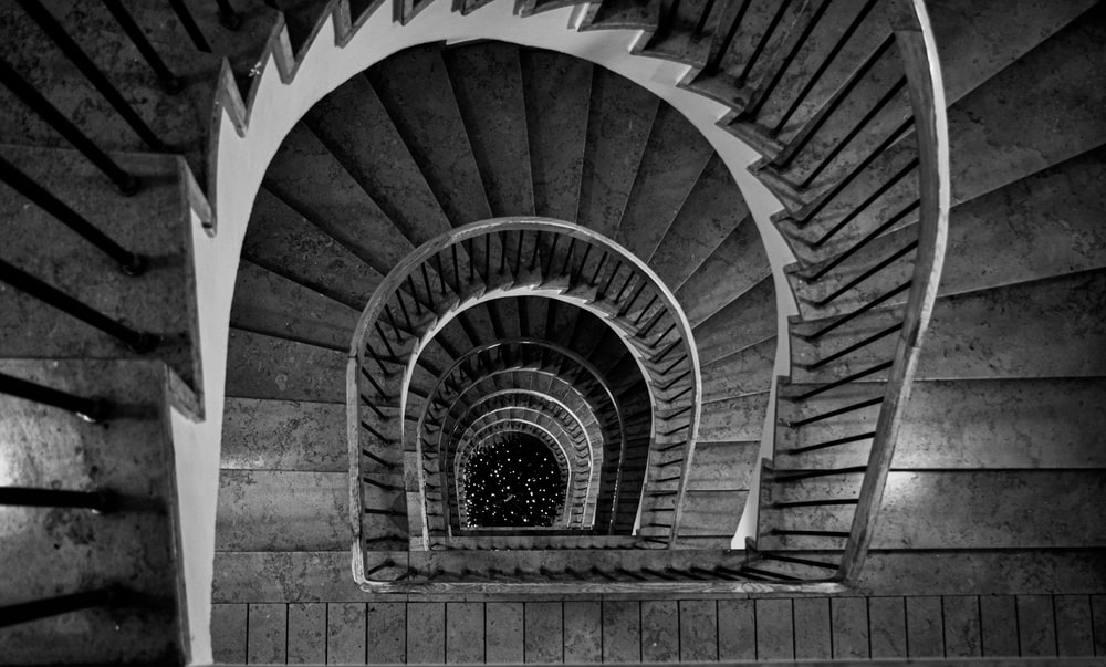 grayscale photography of black and white staircase