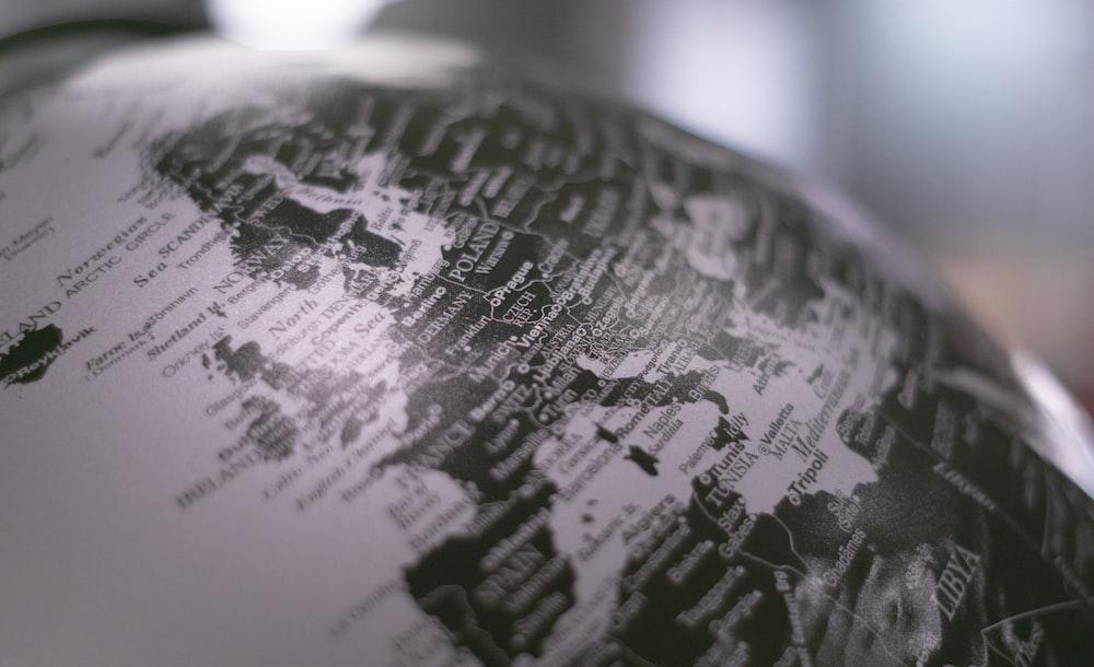 grayscale photo of desk globe