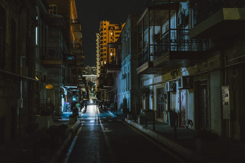 buildings and road during night