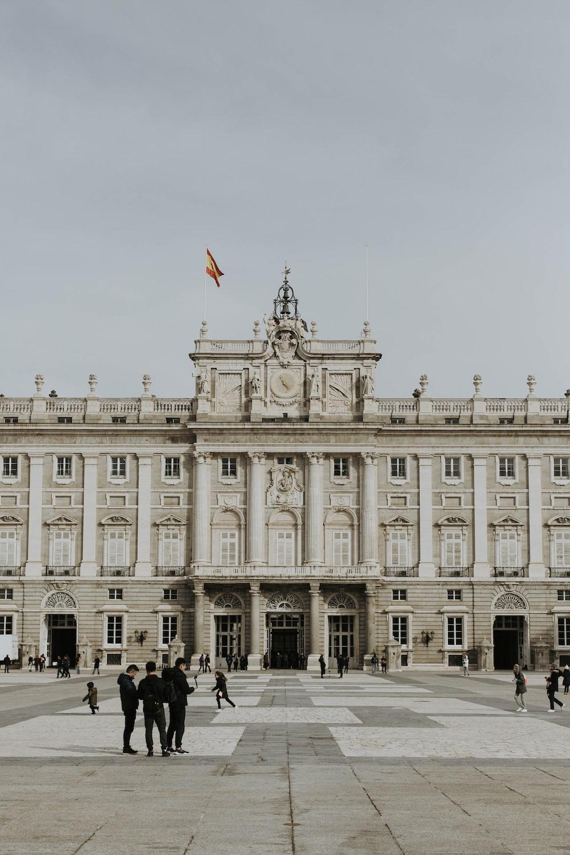 people walking near Royal Palace of Madrid
