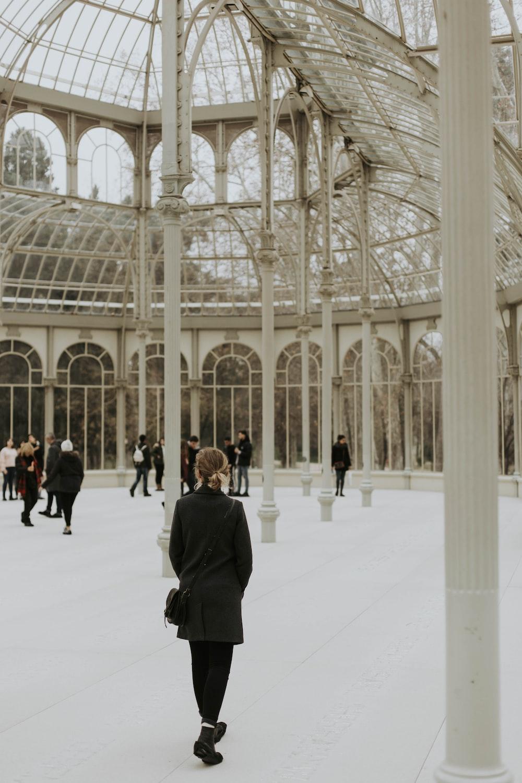 people walking inside dome building