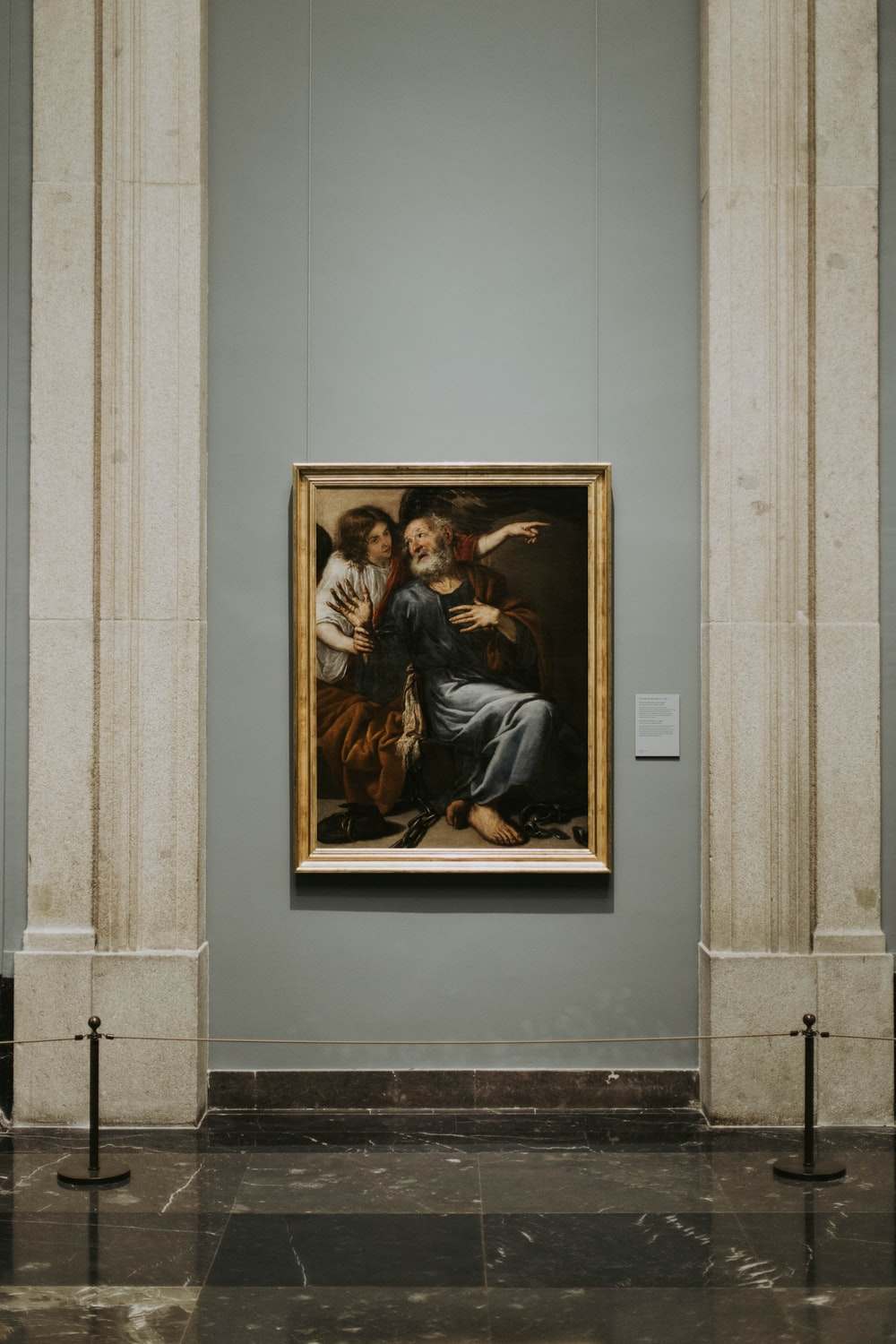 man and woman painting with gold frame
