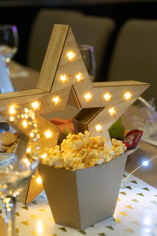 popcorn near lighted star topper