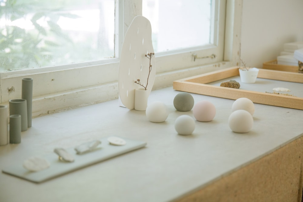 bath bombs on table top by window during daytime