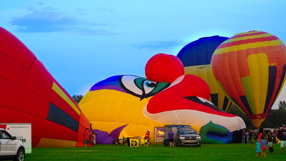 hot air balloon at field during daytime