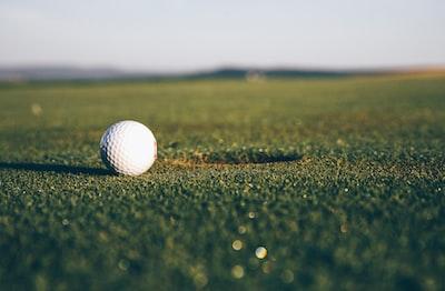 white golf ball golf teams background