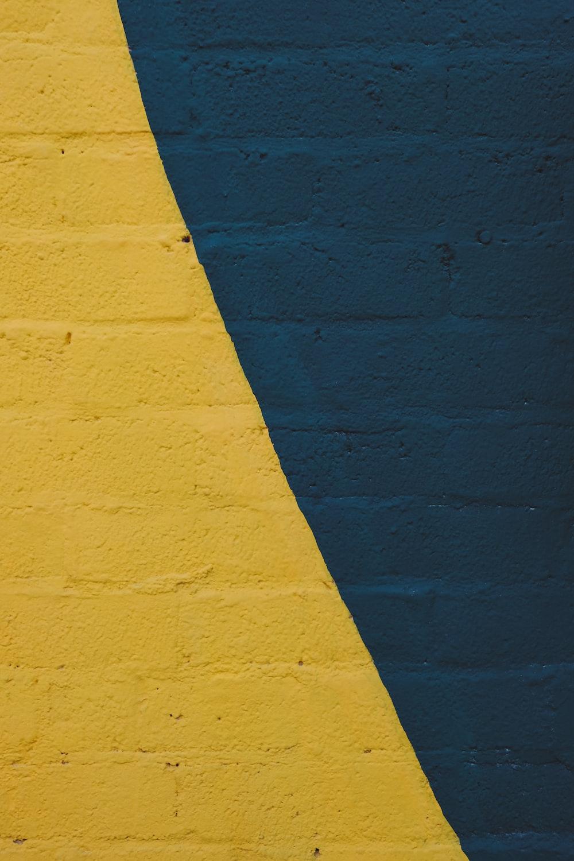 yellow and blue brick wall
