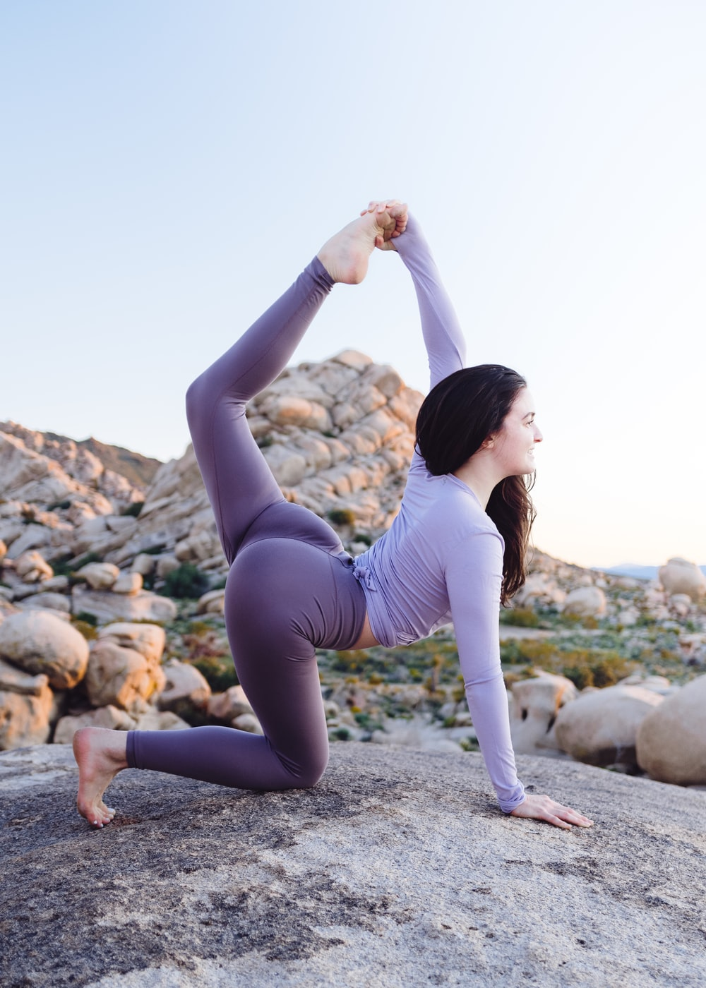 woman stretching on tock