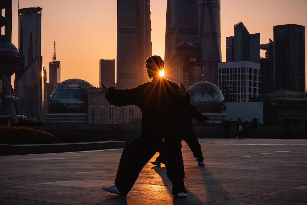 silhouette of man near buildings