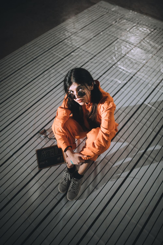 woman in orange windbreaker