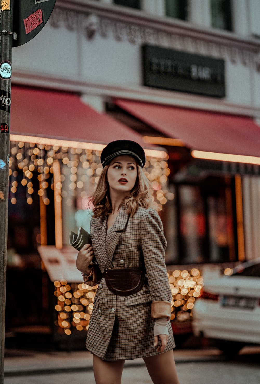 woman walking near vehicle